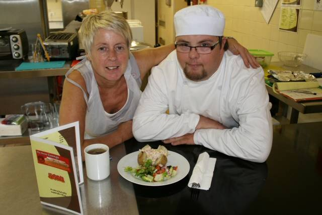 Ryan Banks gets cooking at the Social Lounge with Colette Crookes from the council's Learning Disabilities Service