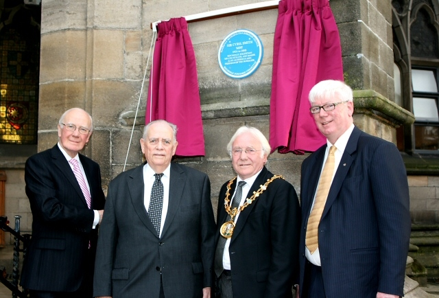 Rt. Hon Sir Menzies Campbell MP, Norman Smith, Mayor Godson and Paul Rowen stood below the blue plaque in memory of Sir Cyril Smith