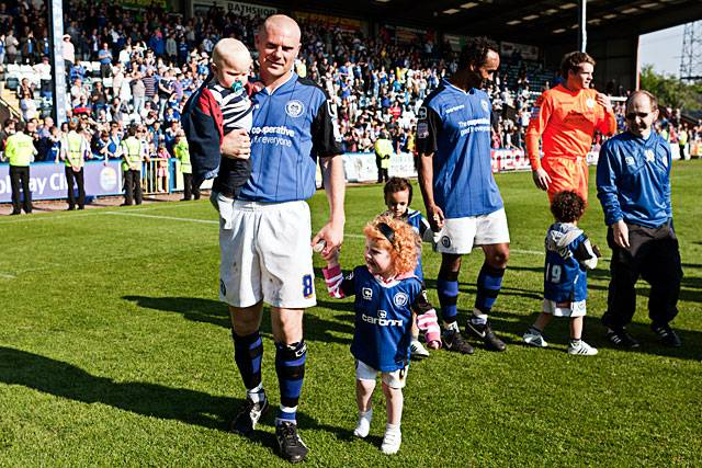 Dale captain Gary Jones with his children on the lap of honour