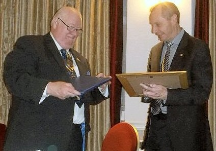 Jeff Lawton, President of Rotary Club of Middleton presenting the Paul Harris Award to Peter Hayward