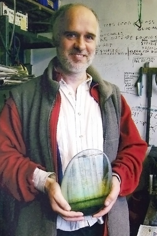 Brian Blanthorn holding a piece of his glass
