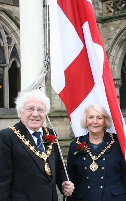 The Mayor, Councillor Alan Godson, and Mayoress, Gillian Brown, with the flag of St George outside Rochdale Town Hall