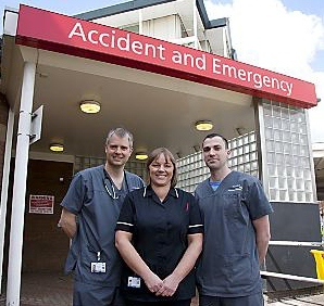 Dr Tom Leckie, Julie Winterbottom and Dr Nick Gili outside the A&E department at The Royal Oldham Hospital