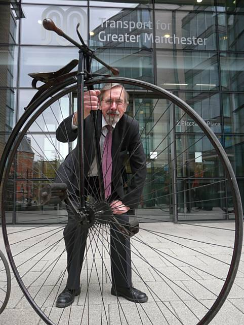 Councillor Andrew Fender, Chair of the TfGM Committee, demonstrates one of the more unusual ways to take part in the Cycle Challenge