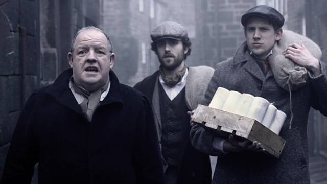 "A scene from ""The Rochdale Pioneers"" – John Henshaw (playing John Holt), Andrew London (playing William Cooper) and, Jordan Dawes (Samuel Ashworth)"