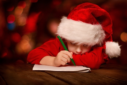 Child writing letter to Father Christmas