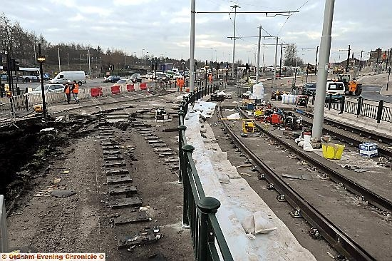 Workmen connecting the Oldham town-centre tracks