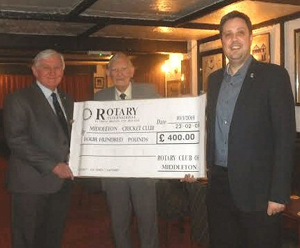 John Burton, Chairman of Middleton Cricket Club (centre) in 2014 with John Brooker and Lee Wolf, Rotary Club of Middleton