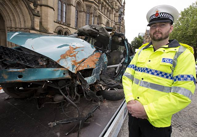 Car wreckage from a drink drive crash on display