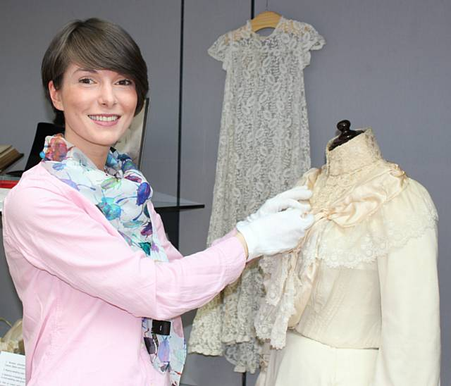 Natalie Rhodes (Art and Heritage Assistant-Museum) with the wedding dress detailed above