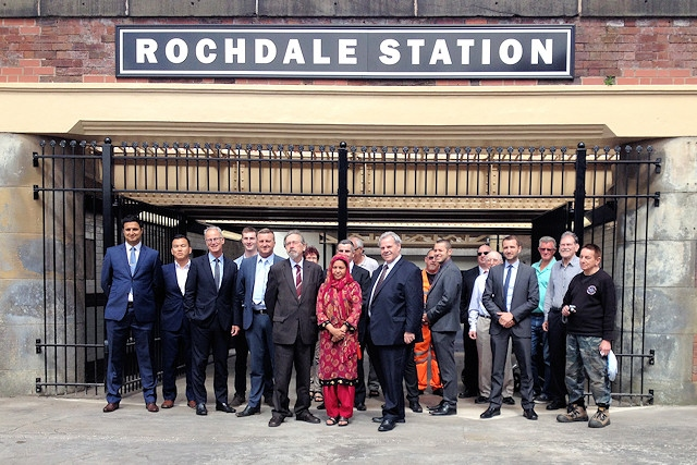 Representatives of Transport for Greater Manchester; Network Rail; Northern Rail and Rochdale Council at the new station entrance on Miall Street