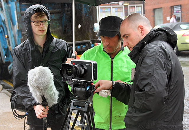 John Farrington (centre) filming in Rochdale