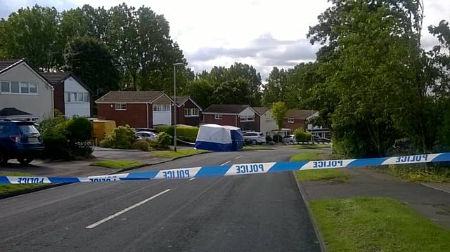 Woman died following stabbing on Shawclough Way, 2 men arrested