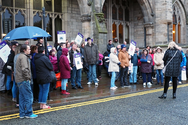 Protestors against remodelling adult supported living care outside Rochdale Town Hall