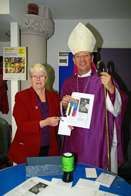 Jo Hill, of St Andrew's, a member of Amnesty International (Manchester) with The Rt Revd Mark Davies, Bishop of Middleton
