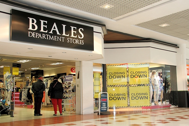 Closing down signs in the shop windows at Beales