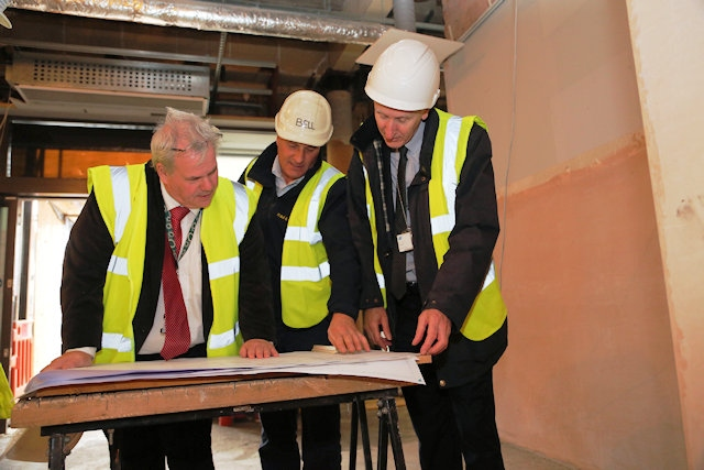 Councillor Richard Farnell, leader of Rochdale Borough Council, Chris Bell, Managing Director of H Bell and Sons, and Tony Burgess, building surveyor at Rochdale Borough Council
