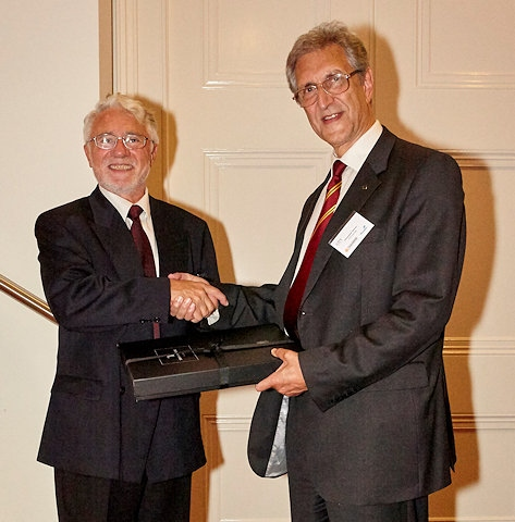 Professor Nikola Stosic (left) recognises the considerable contributions made by Dr. Christopher Holmes (right), to the International Conference on Compressors and their Systems