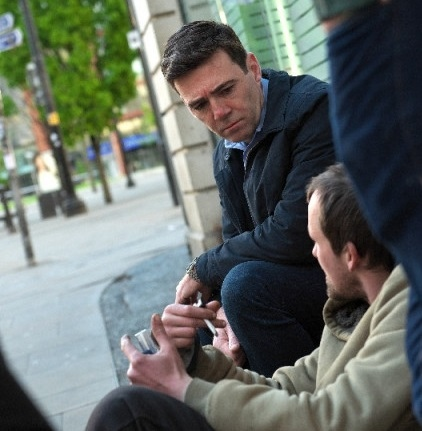 The Mayor of Greater Manchester Andy Burnham speaking to a homeless man