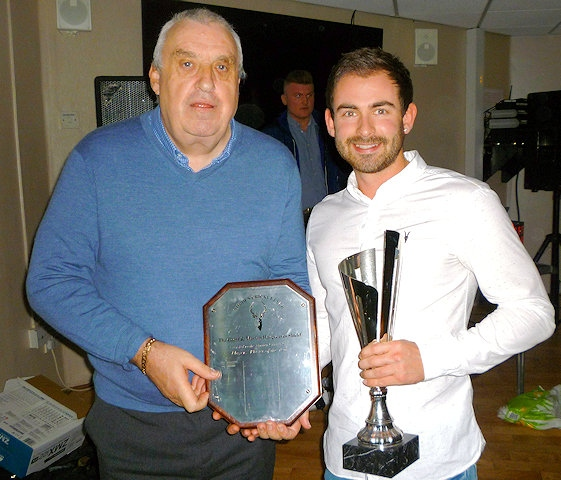 Norden Cricket Club chairman John Murphy presenting player of the year Josh Tolley with his trophy