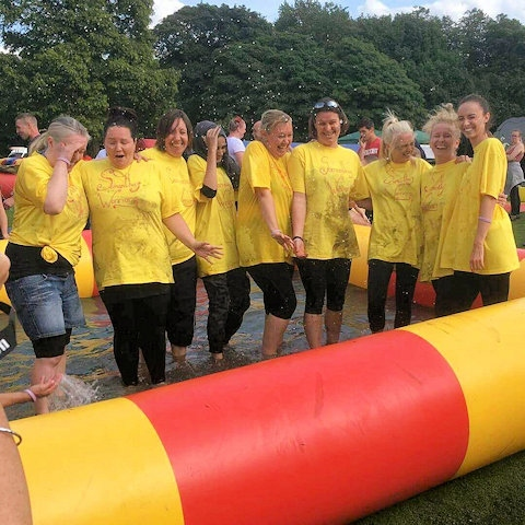 Members of fostering team after completing their It's a Knockout challenge