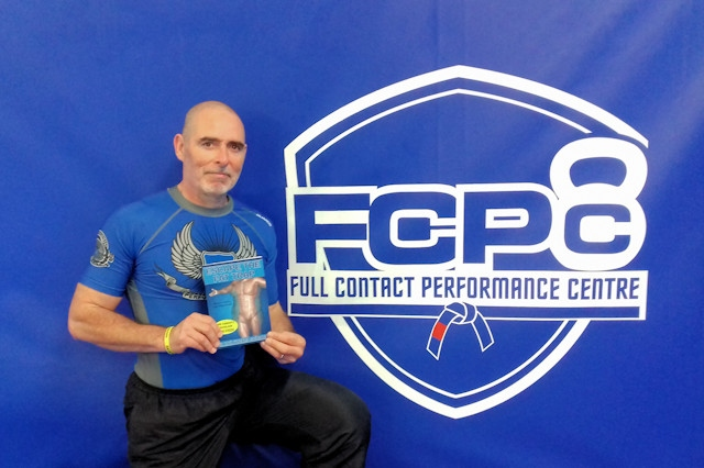 Dr David Penney with his book at the Full Contact Performance Centre