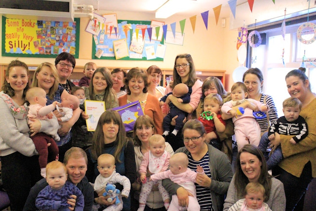 Irene celebrates with Councillor Janet Emsley, and Middleton parents and toddlers