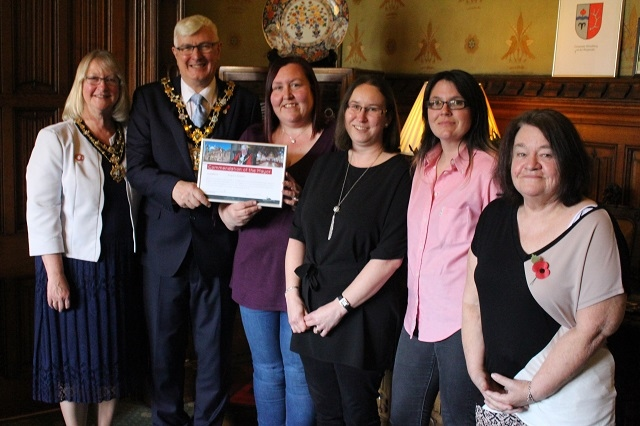 MayorIan Duckworth and Mayoress Christine Duckworth present a certificate of commendation to Angie Howarth, Diane Nattress, Claire Buckley and Jenni Jones
