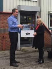 Limes manager Collette Heaton receiving a printer from James Waldron