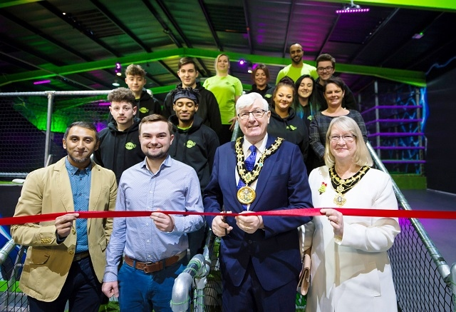 Imran Matadar, general manager with Cllr Danny Meredith, The Mayor, Ian Duckworth, Mayoress Christine Duckworth and the Flip Out team