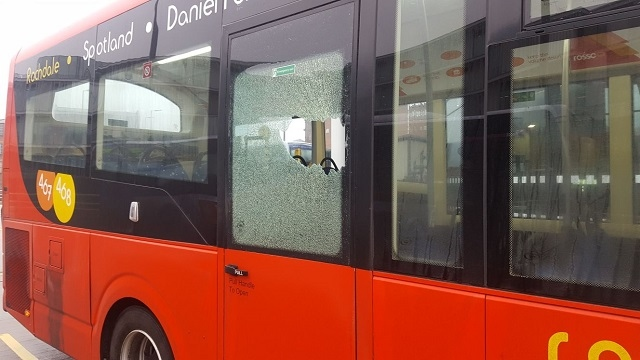 464 Rosso Bus damaged by school children with bricks
