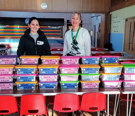 Katie Lloyd and Jackie Barber with the boxes from Littleborough Community Primary School
