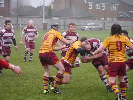 Rochdale RUFC Captain Callaghan takes the hit