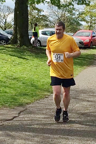 Councillor Chris Furlong running in the Bolton 10k last year