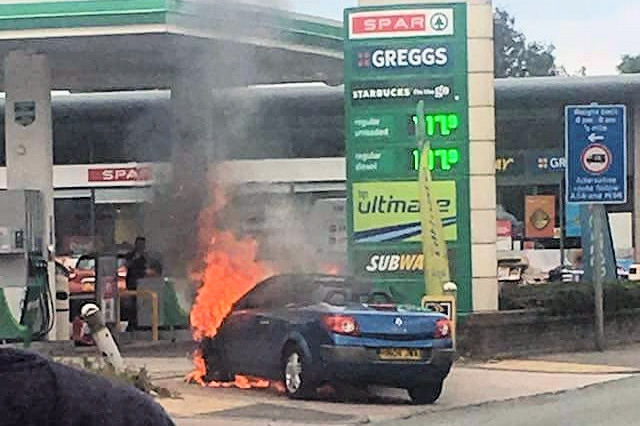 The car burst into flames at the BP petrol station on Bury New Road in Heywood