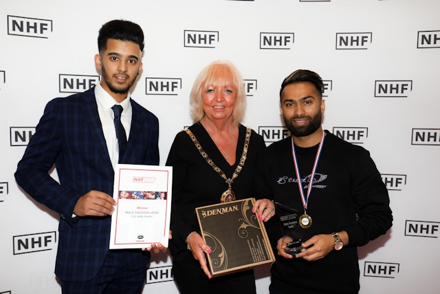 Lixon Chaudhury (right) has been crowned one of the UK's best barbers. Pictured here with his model and NHF President, Agnes Leonard