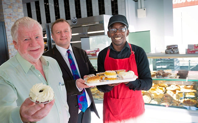Cllr Allen Brett, market manager David Bellis and Patrick Jarrett from Patrick's Bread in Rochdale Market