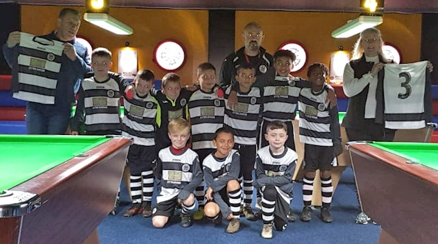 Wardle U9 Blacks show off their new kit at Miss Q's