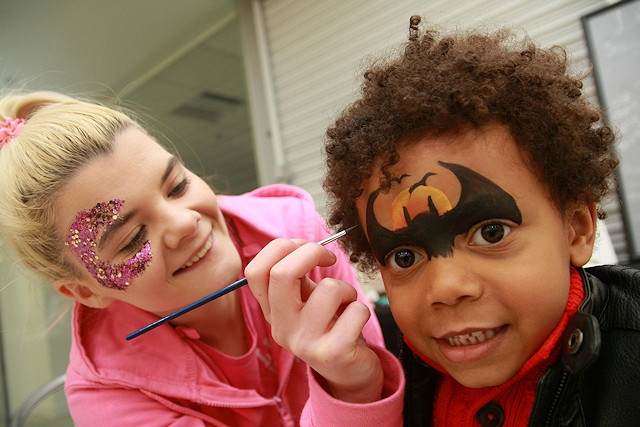 Luca Sodje has his face painted by Sarah McFarland of Little Unicorn Face Painting
