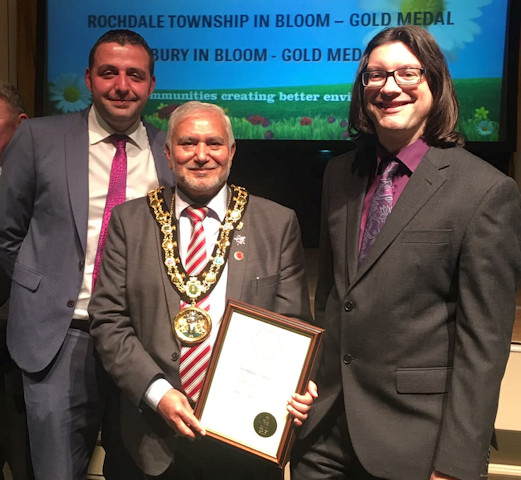 Accepting the gold for Rochdale