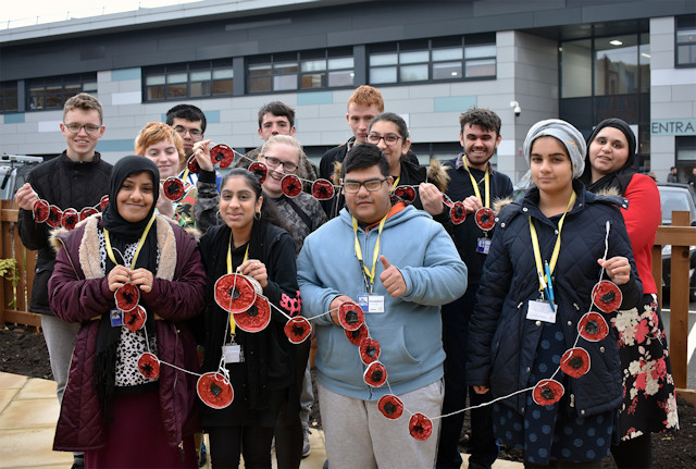 Skills for Life students and the recycled poppies they created