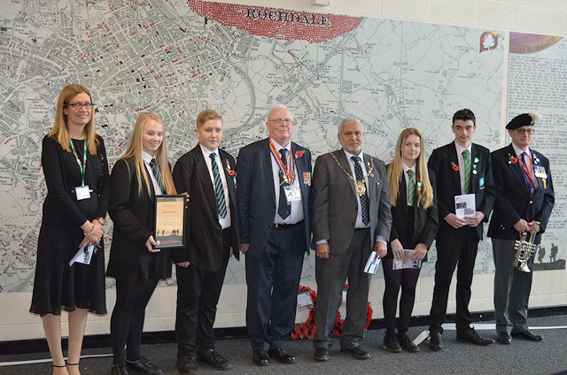Rebecca Tarran (Teaching and Learning Director – Humanities); Jenna Holt and Jake Idiens (designers of the legacy project); Wing Commander David Forbes (President of the Rochdale branch of the British Legion); the Mayor Of Rochdale; Lily Mangan (Head Girl); Alex Peckitt (Head Boy); Mr Lawson (who played the Last Post on the bugle)