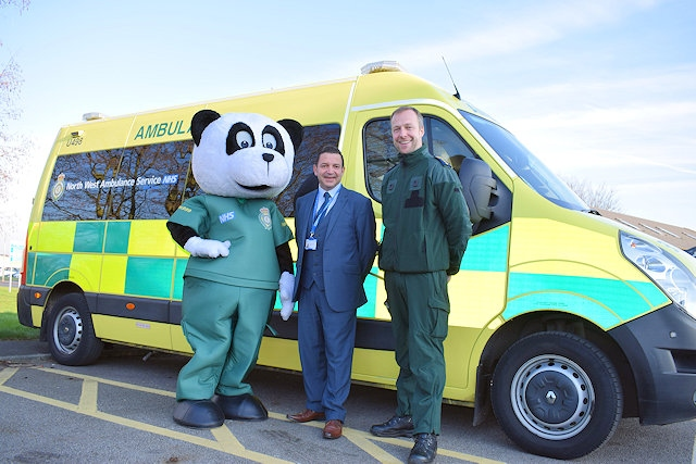 North West Ambulance Charity evolution Manager, Vincent Sherard-Bornshin (centre), with mascot Pandamedic (left) and David McNally, Community tryst  and Resuscitation Manager at North West Ambulance Service (right)