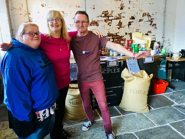 Pantry volunteers Kim, Sandra and Andy