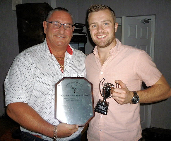 Greg Butterworth receives the Asif Mujtaba Shield and the Marion Hargreaves Trophy as the Norden Cricket Club players' player of the year from Ian Austin
