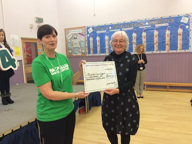 A representative from Macmillan was presented with the cheque
