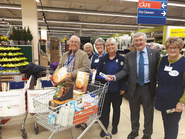 Rochdale MP Tony Lloyd with Foodbank volunteers at Tesco, Sudden