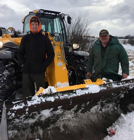 Farmers Elliot Eaton Greenwood and Stewart Greenwood ensuring the roads are clear