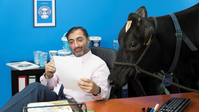 Azhar Zouq, managing director of Lancashire Farm Dairies and Olympia the cow