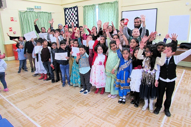 Children at Deeplish Community Centre proudly show off their certificates